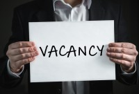 Person holding Vacancy sign